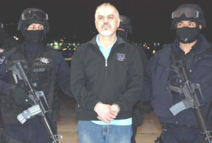 Eduardo Arellano (Tijuana Cartel) at the Federal Police hangar being presented to the press.