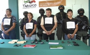 Mexican police officers escort suspected members of the ZETAS drug cartel during a presentation to the media.